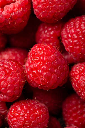 A closeup shot of cute fresh raspberries one on another 스톡 콘텐츠