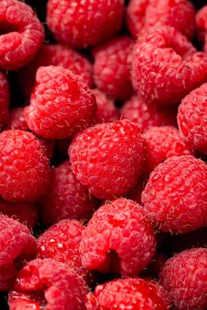 A closeup shot of cute fresh raspberries one on another Foto de archivo