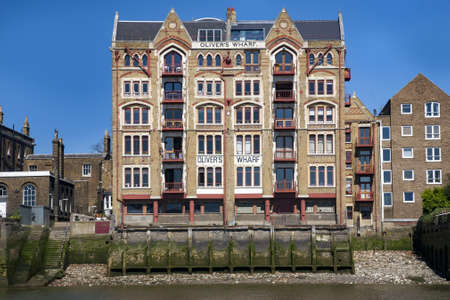 The Oliver's Wharf building on the north bank of the River Thames in East London, UK
