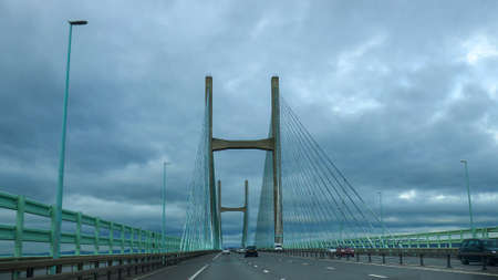 Some cars on the Prince of Wales Bridge on a cloudy day