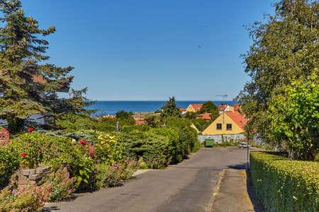 A street leading down towards Baltic sea in Svaneke, Bornholm island, Denmark