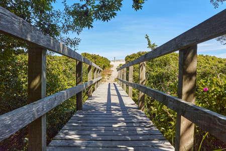 A wooden bridge across Oleaen Stream on Bornholm island flowing into the Baltic sea near Slusegaard, Denmark