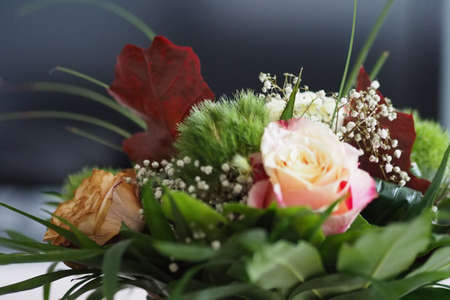 A closeup shot of a bouquet of roses and other flowers Archivio Fotografico