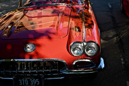 DOWNERS GROVE, UNITED STATES - Jun 07, 2019: A nice antique red car at the parking lot in Downers Grove, United States