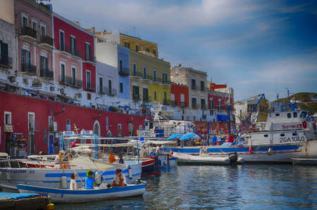 A shot of boats and colorful buildings in the commune of Ponza in Lazio, Italy 免版税图像