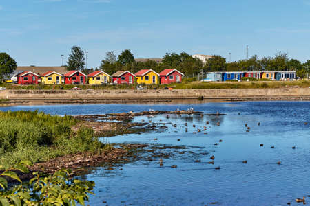 A lot of colorful houses on the coast of Baltic sea in Nexo, Bornholm island, Denmark