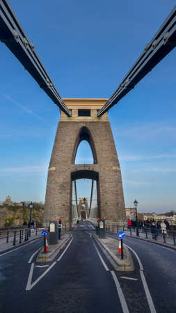 BRISTOL, UNITED KINGDOM - Dec 24, 2019: A beautiful shot of Brunel suspension bridge in Bristol, the United Kingdom with blue sky.
