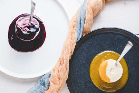 A selective focus shot of creamy desserts on the plate