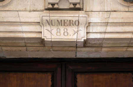 A number 88 sculpted on a stone in Spanish