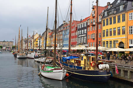 COPENHAGEN, DENMARK - Jul 13, 2018: Nyhavn is a 17th-century waterfront, canal and entertainment district in Copenhagen, this is one of the city's main attractions.