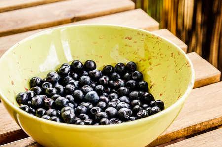 A closeup shot of fresh European blueberries in a bowl 스톡 콘텐츠