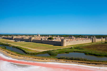 A wide angle shot of the city of Camarque in France in front of salt lakes