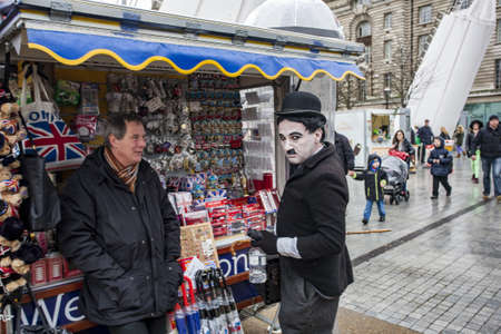 LONDON, UNITED KINGDOM - Feb 20, 2014: Charlie Chaplin impersonator on the south Bank of the River Thames in London, UK 新闻类图片