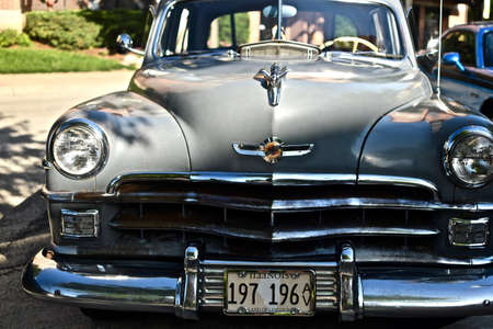 DOWNERS GROVE, UNITED STATES - Jun 07, 2019: A closeup shot of an old retro car in the parking lot in Downers Grove, United States