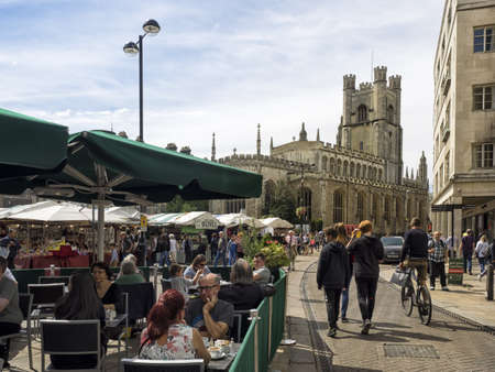 CAMBRIDGE, UNITED KINGDOM - Aug 11, 2017: CAMBRIDGE, UK:  The Historic Market in Market Square overlooked by Great St Mary's Church