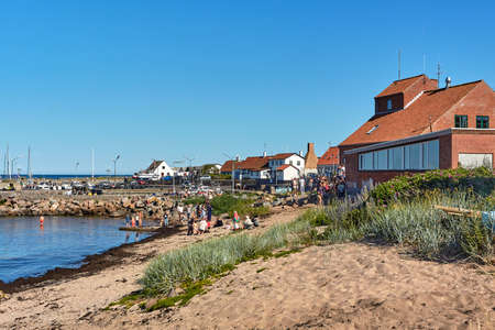 AARSDALE, DENMARK - Jun 28, 2019: Aarsdale, Bornholm island, Denmark - June 28, 2019. Local people and tourists celebrating official opening of Mikkeller Aarsdale bar and pub.
