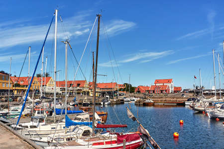 SVANEKE, DENMARK - Jun 28, 2019: Svaneke, Bornholm island, Denmark - June 28, 2019. Yachts moored in Svaneke marina