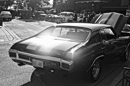DOWNERS GROVE, UNITED STATES - Jun 07, 2019: A grayscale shot of a shiny vintage car