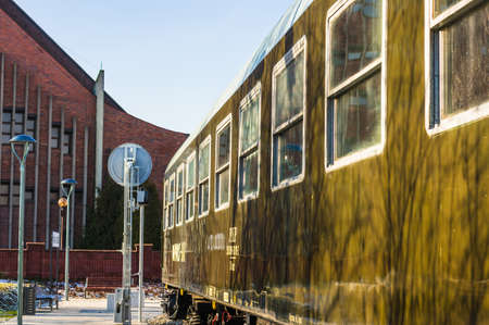 POZNAN, POLAND - Jan 19, 2019: Close up of a old train wagon in the Rataje park. 에디토리얼
