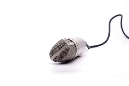 A microphone with a cable isolated on a white background Banco de Imagens