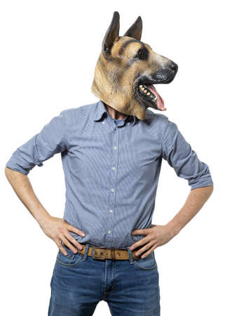 A vertical shot of a male in a dog mask holding the hands on waist Banco de Imagens