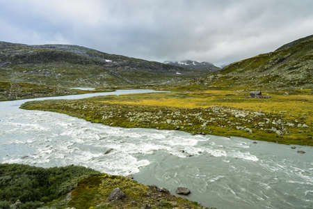 A river in the scenic mountain landscape near in Finse, Hordaland, Norway