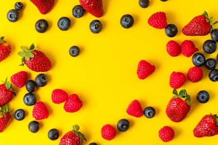 A closeup shot of fresh berries on a yellow background Banco de Imagens