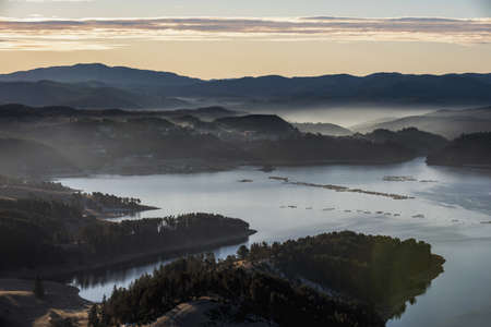 An aerial view of Dospat dam in the Rhodope Mountains, Bulgaria during the sunrise