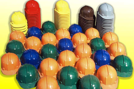 A closeup shot of many colorful industrial safety helmets