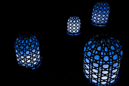 A closeup of blue lamps in a dark room - cool for backgrounds and wallpapers