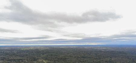 A panoramic shot of fields covered in trees in Presa Almendro. Salamanca, Spain
