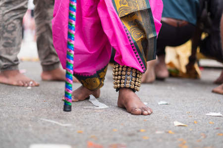 Thaipusam is a religious celebration by devotees. Its highlight is a barefoot walk of devotees carrying milk pots and dancing with prickly kavadis.