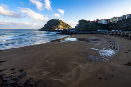 The sandy beach during daytime in Getaria, Spain