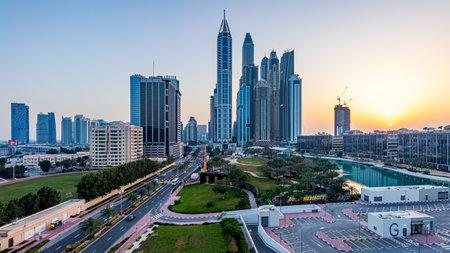 DUBAI, UNITED ARAB EMIRATES - Mar 08, 2020: Dubai Media City's skyline during sunset, with the Dubai Marina skyline appearing as well. 報道画像