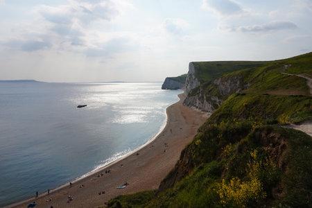 A landscape of Dorset AONB in Dorchester, UK under a cloudy sky