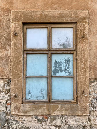 An old window of an old abandoned building