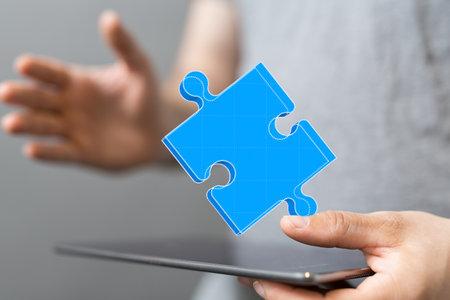 puzzle hand solution concept business