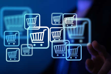 An internet marketing concept. Man with virtual trolley icons developing internet marketing strategies