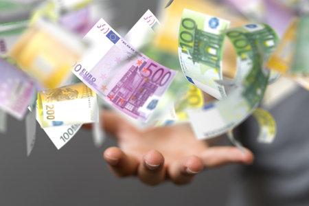 A closeup shot of a person presenting a euro rain with different bills Stock fotó