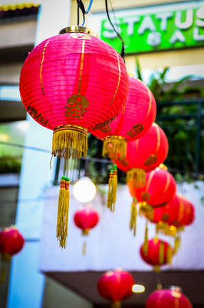 A vertical shot of Chinese lamps hanging in a line