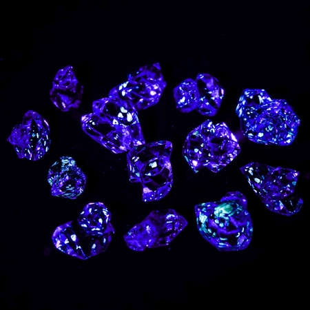 Herkimer gemstones with oil inside shining blue under a UV light Archivio Fotografico
