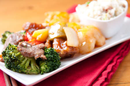 tasty chinese food with fried rice, beef, chicken and fresh vege