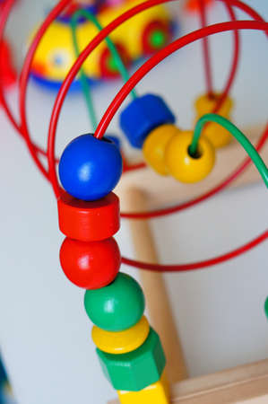 A multicolored toy for children on a small wooden construction