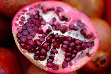 A closeup shot of a cut pomegranate on a blurred background Stok Fotoğraf