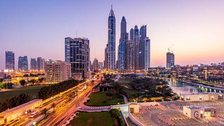 DUBAI, UNITED ARAB EMIRATES - Mar 08, 2020: Dubai Media City's skyline during blue hour after sunset.