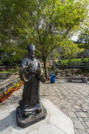A vertical shot of the statue of Padre Matteo Ricci, an Italian priest in China, Macau