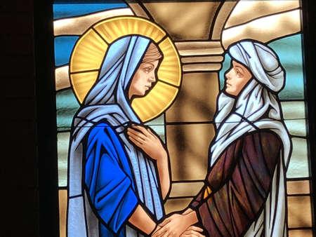 Stained Glass image of the Visitation taken at St. Elizabeth Seton Catholic Church.