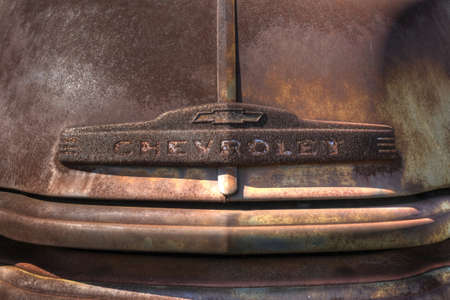 SPRINGFIELD, UNITED STATES - Jan 10, 2018: Photo closeup of rusted hood and emblem on an old Chevy pickup