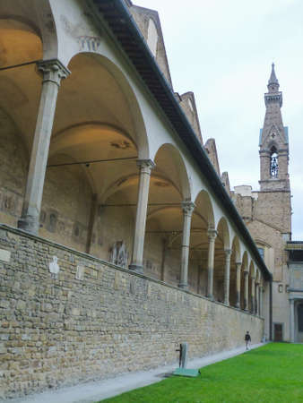 A low angle shot of the steeple and the arches at the courtyard of Basilica of Santa Croce in Florence Italy Archivio Fotografico