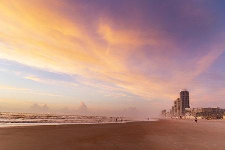 A beach and sunset in Daytona Beach, Florida Imagens